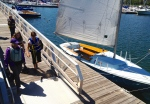 Three generations prepare to go sailing together